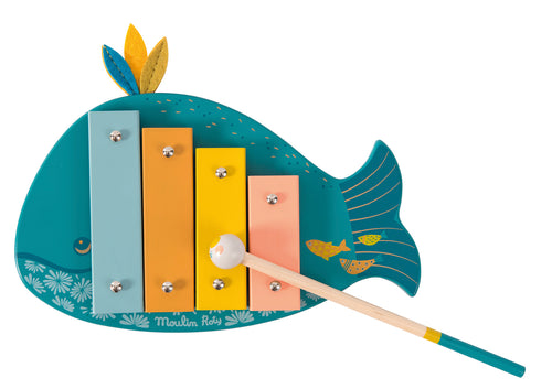In colours of teal, ochre, pink and orange, Josephine is decorated with tiny fish and fabric feathers for good luck. This multi-coloured xylophone really works and comes with a wooden mallet to strike each tuned bar.