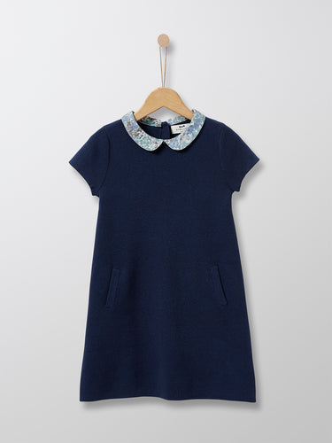 This 100% cotton Navy knit dress is adorned with an elegant collar in Liberty floral fabric. This classic Parisian dress is ideal for special occasions and every day chic wear alike.