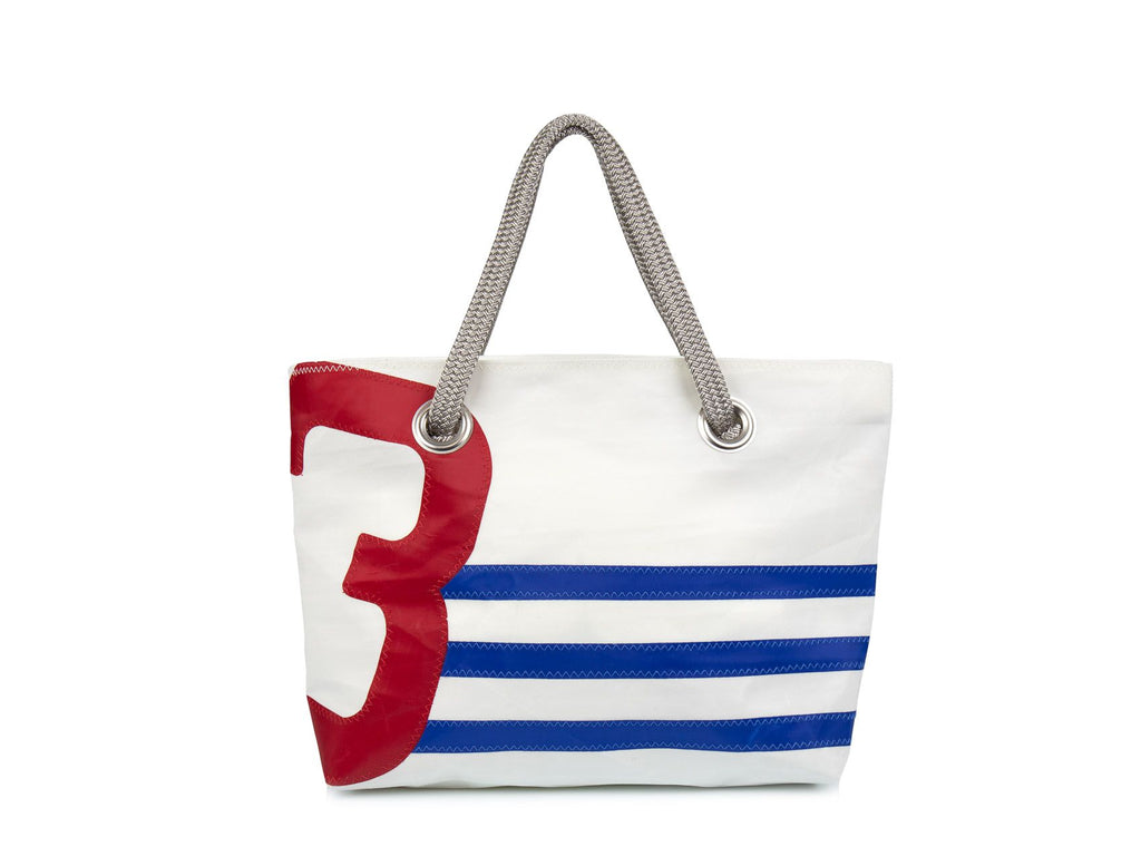 White with blue stripes and an over sized red number, this women's carry bag is made from 100% recycled sails.