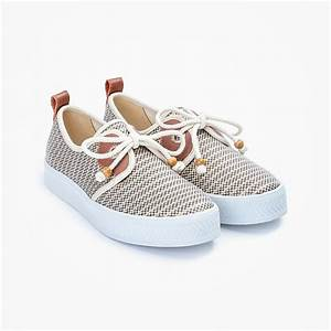 Women's lace-up platform sneakers from France, with 3cm-platform soles and canvas upper in gold stripes, with nautical style rope shoelaces with wood aglets, gold eyelets, and brown leather yokes.