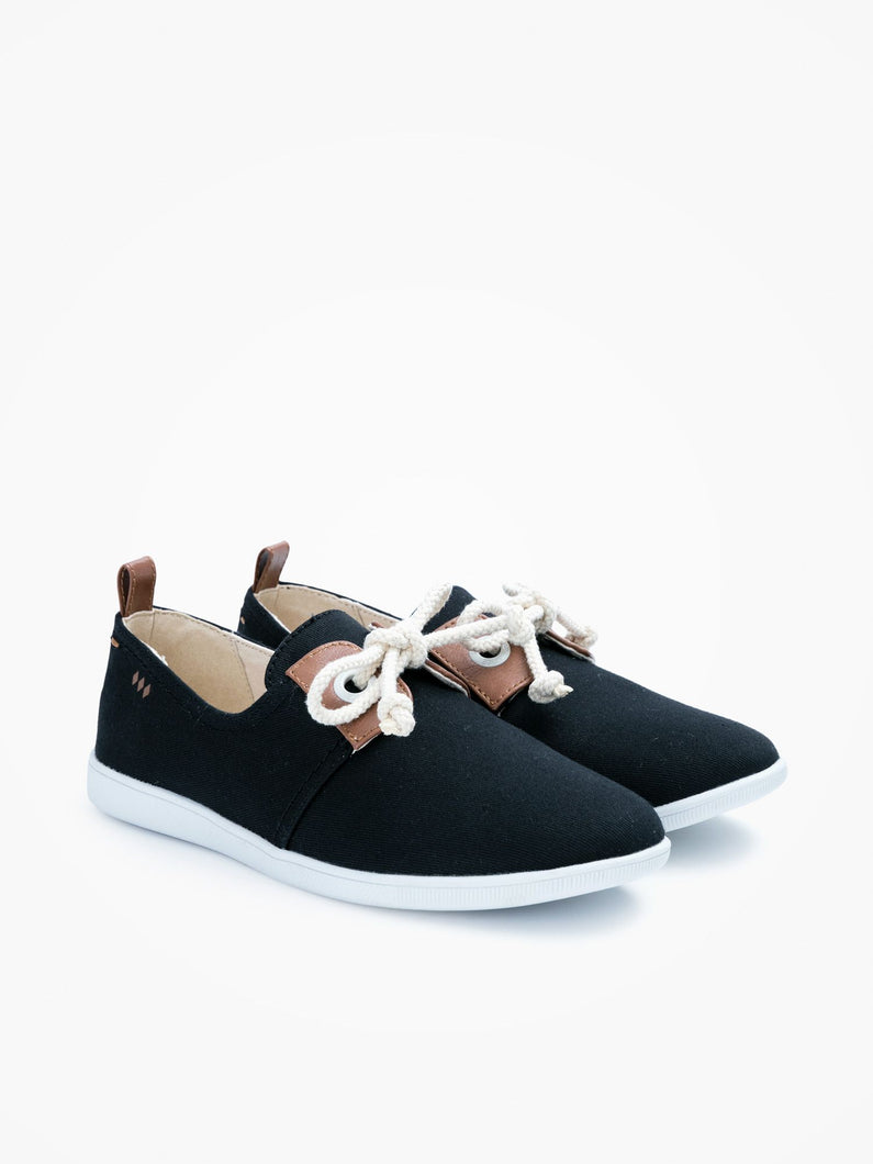 This minimalist black canvas sneaker is packed with neo-retro style and nautical inspiration with details such as oversized eyelets, leather yokes and marine-inspired cord laces.