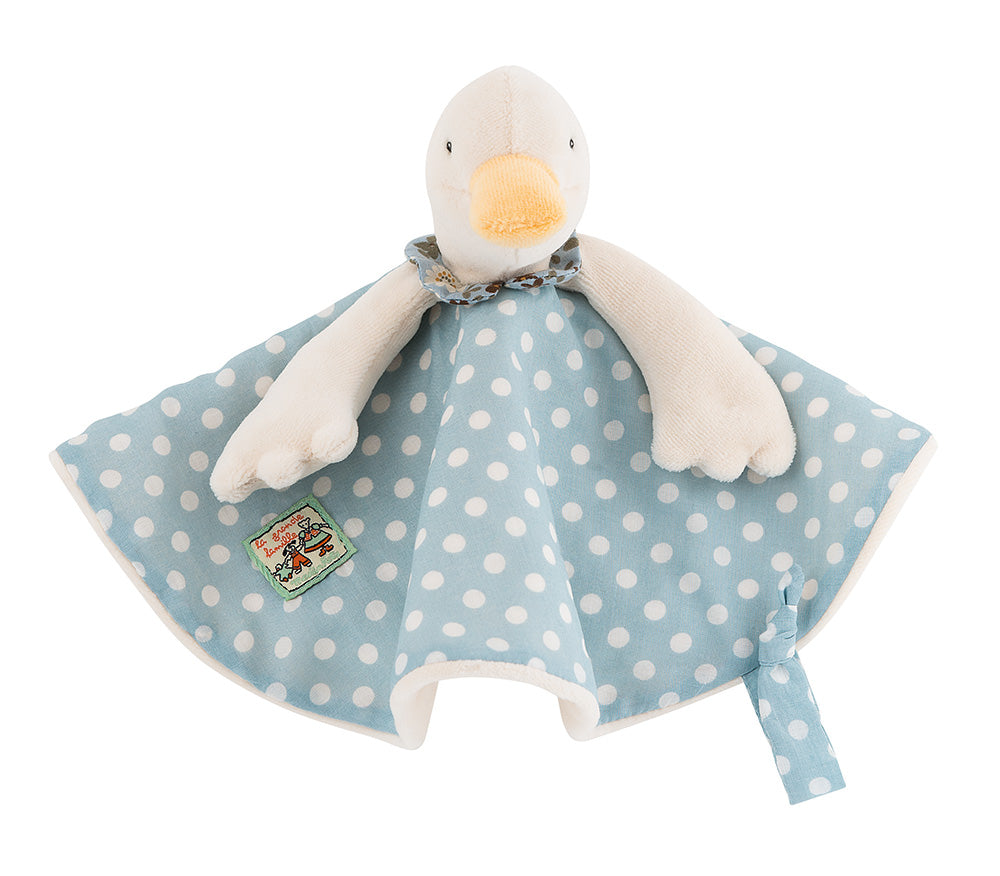 Little Jeanne the Goose, in her blue and white polka dot printed cotton dress, lined in velvet to create a flat comforter easy for baby's little hands to grasp. It includes a strap to attach a pacifier.