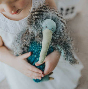This super soft Kiwi bird sits squarely on his thick black and grey feather plumage. He boasts a long, corduroy green beak, a soft body of floral blue and green, with corduroy green feet and dark grey claws.
