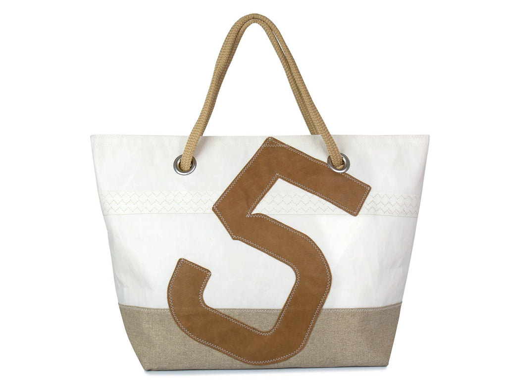 A stylish women's day bag made from recycled sails, linen and leather. Colours are camel and natural linen. It is sized for a day at the beach or a weekend getaway.