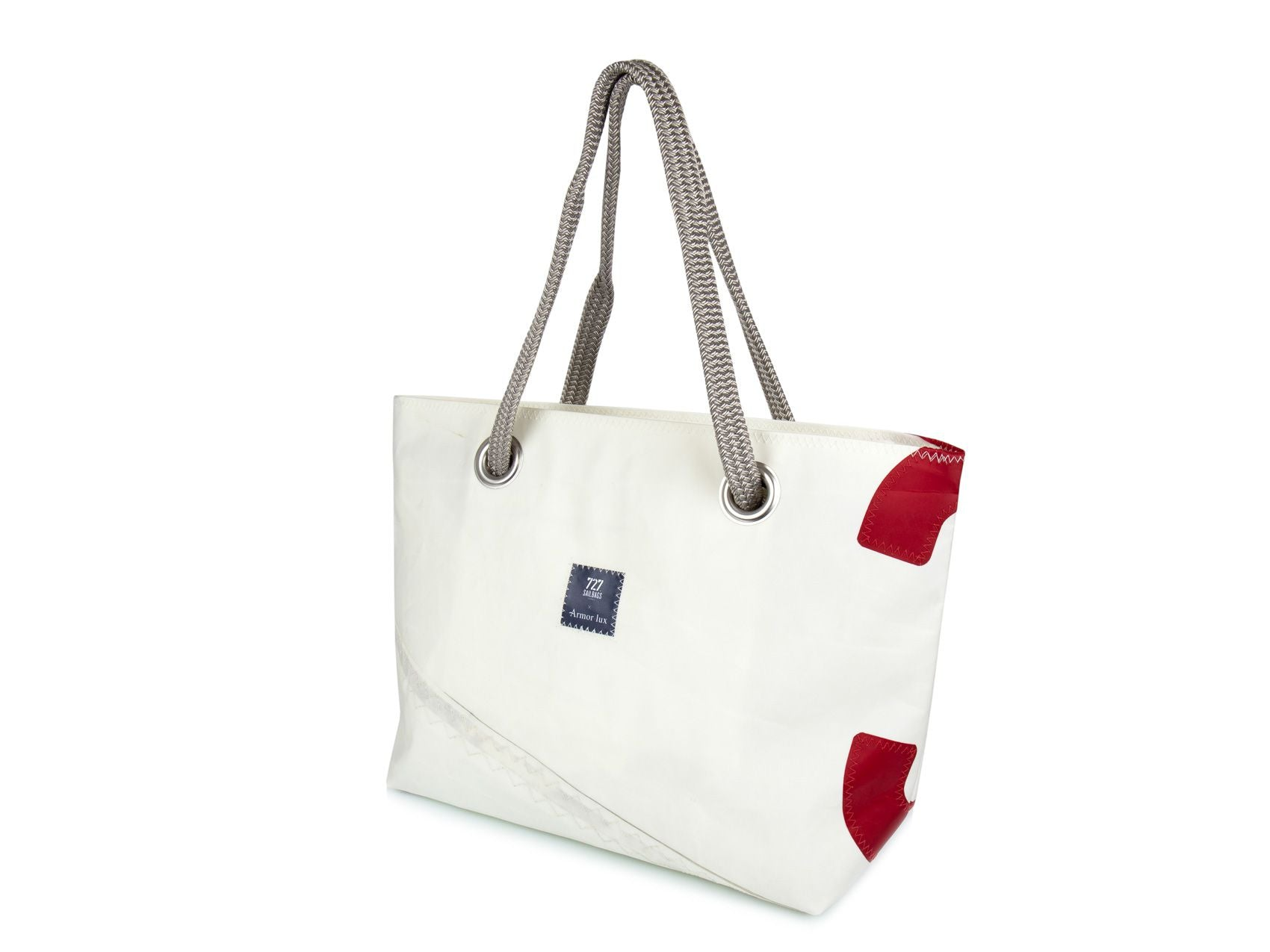 With its blue stripes and red number, the Charlie carry bag by 727Sailbags has been designed for lovers of all things nautical with a strong sense of fashion. Hand-sewn in France, this chic and practical carry bag is made from 100% recycled sails.