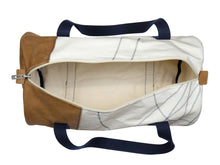 Load image into Gallery viewer, The Onshore travel bag from 727Sailsbags is made from 100% recycled sails, crafted and hand-sewn by expert seamstresses in France. It comes in beige and camel tones here. The sails come from the last-surviving tall ship from the 19th century, the Belem. It is a truly unique, vintage travel bag for men, sized perfectly for weekend getaways or longer breaks. The nautical fan in your life will love it!