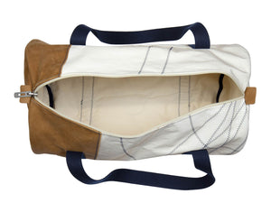The Onshore travel bag from 727Sailsbags is made from 100% recycled sails, crafted and hand-sewn by expert seamstresses in France. It comes in beige and camel tones here. The sails come from the last-surviving tall ship from the 19th century, the Belem. It is a truly unique, vintage travel bag for men, sized perfectly for weekend getaways or longer breaks. The nautical fan in your life will love it!