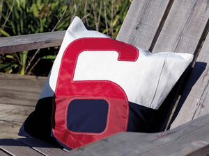 50x50 cushion made from 100% recycled sails. White and navy adorned with an oversized red number.