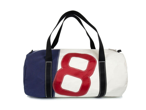 Stylish men's travel bag made in recycled sailcloth. White and blue sail, with oversized red number. Very resistant and perfect size for weekend getaways and short breaks.