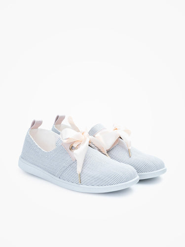 This French 'Marina' neo retro sneaker comes packed with elegant details such as cream silk ribbon shoelaces which complement beautifully its nautical inspiration with oversized eyelets and leather yokes.