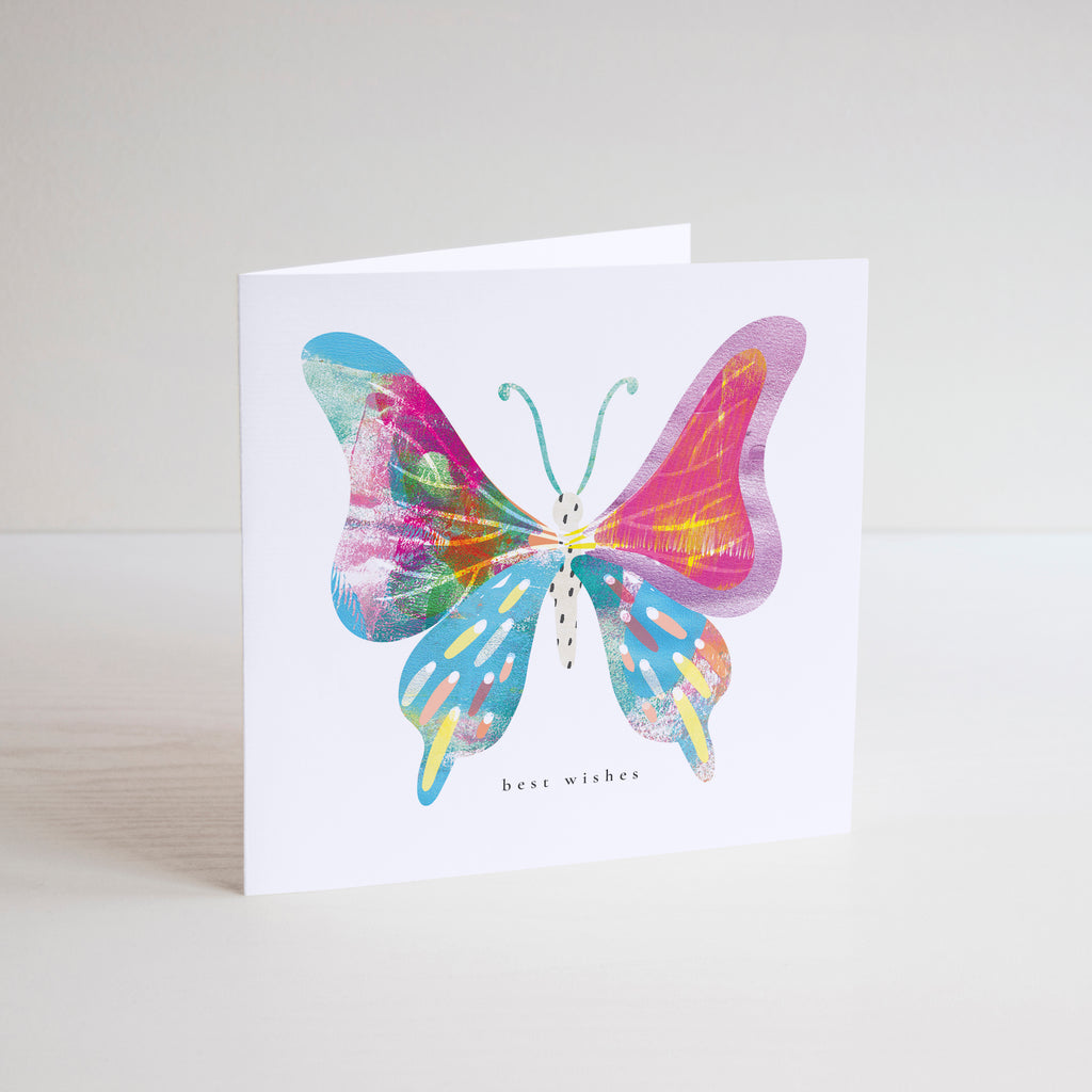 Best wishes greetings card with a big blue, pink and yellow butterfly  illustration.