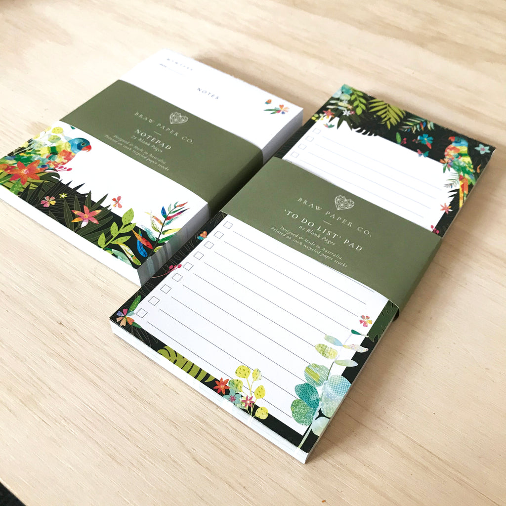 Lined to do list notepad with lorikeet bird, butterflies and Australian native flora illustration next to a notepad with the same design.