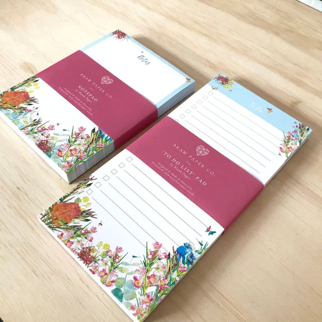 Lined to do list notepad with blue wren bird, butterflies and Australian native flora illustration next to a notepad with the same design.
