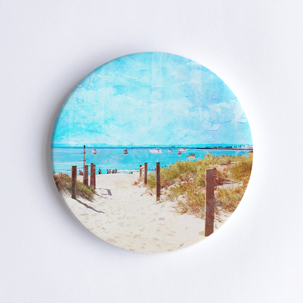 Round, hand printed ceramic coaster with illustration of South Beach in Western Australia showing a sand path through the dunes.