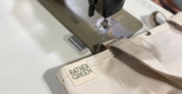 Bag being sewn with Rather Green label on.