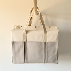 Canvas bag with pockets inside and out.