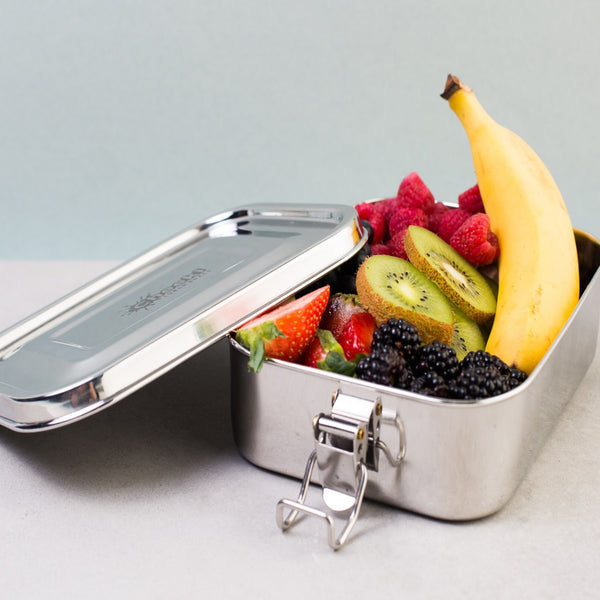 Cheeki Stainless Steel Lunch Box 2 Layers 1L Stylised Image holding fruit