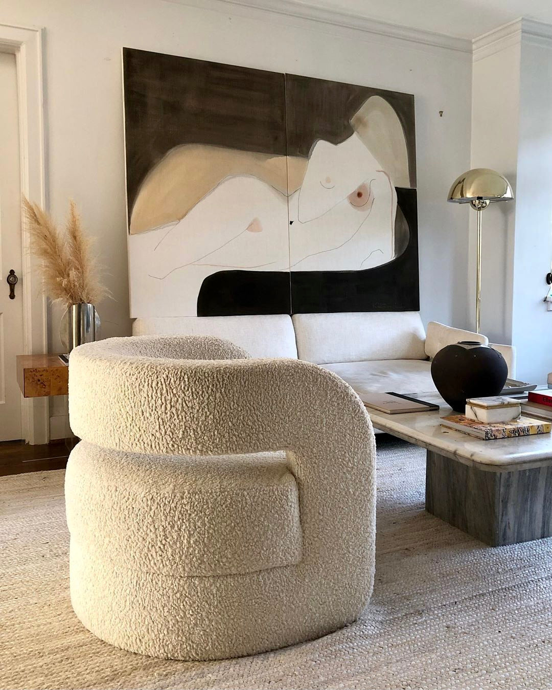 Cream boucle chair with Kristen Giorgi painting