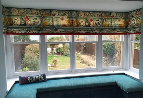 roman blinds in a box bay window
