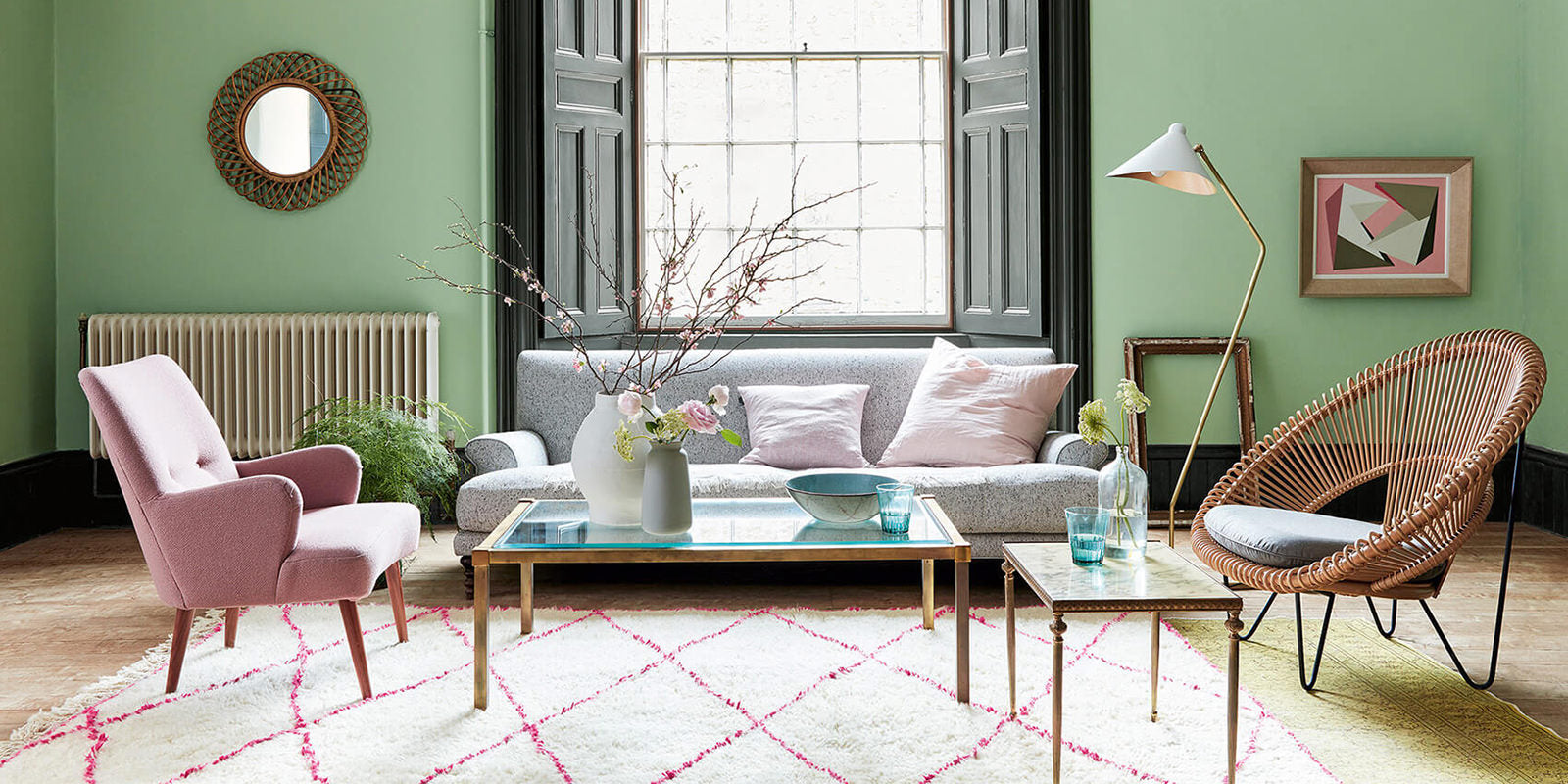 Room colour scheme with pale grey sofa, pink armchairs, mint green walls