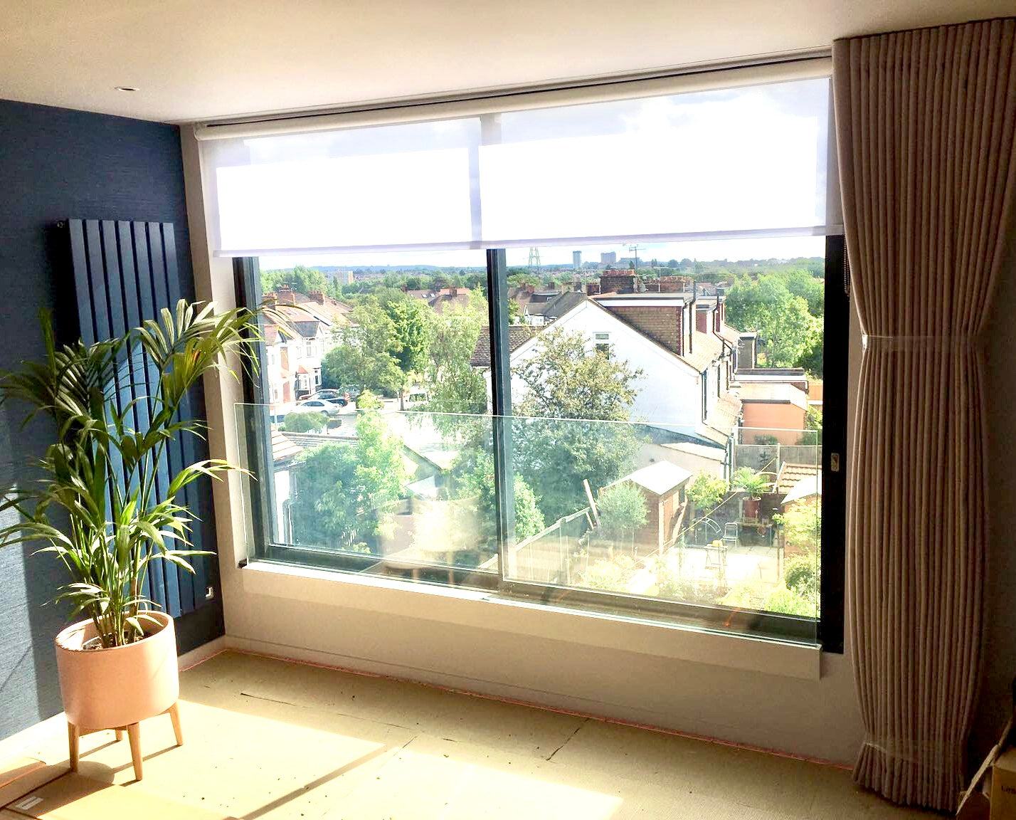 Blackout Wave Curtain with Privacy Roller Blinds on Large Loft Window