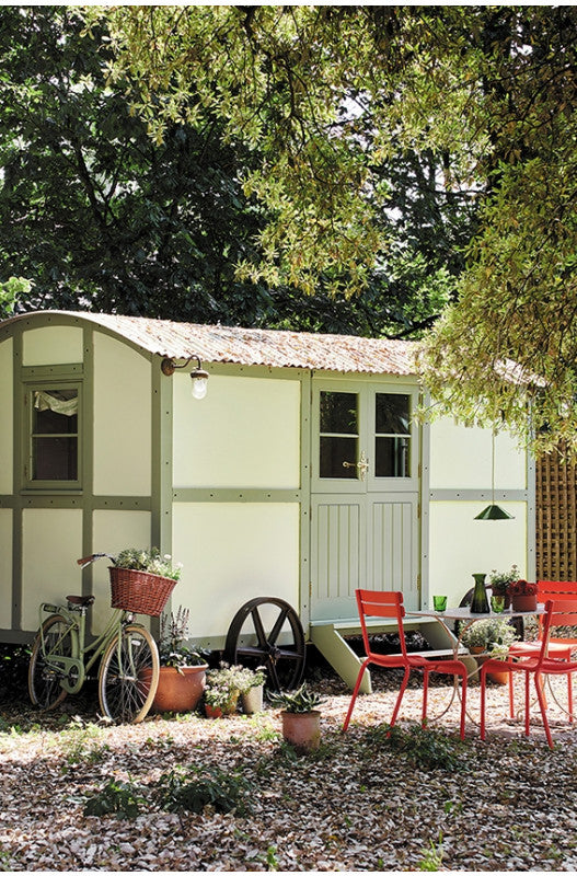 Painted Garden Shed with brightly coloured table and chairs