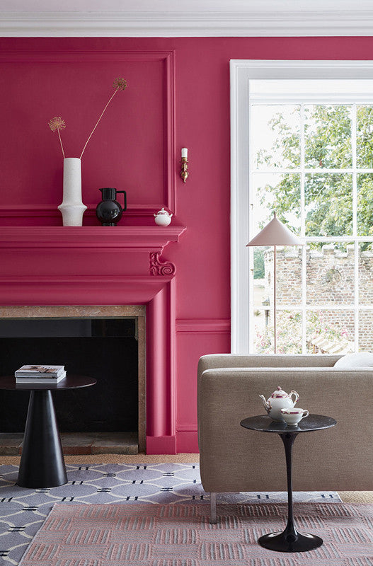 Bright pink painted walls, fireplace and panelling