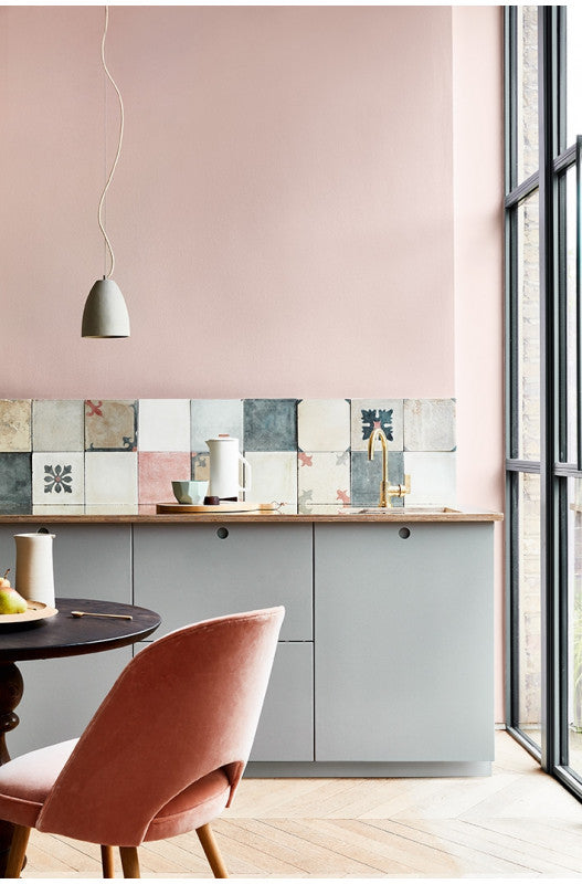 Kitchen painted in pale pink with blue/grey cabinets