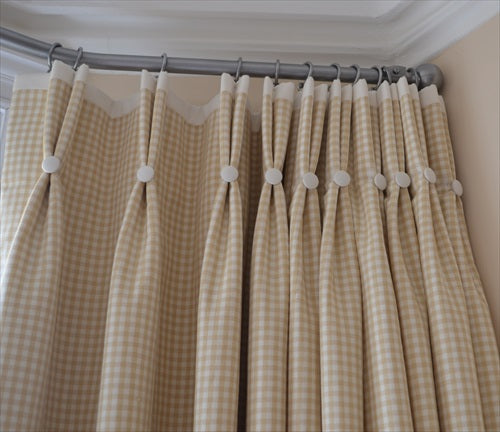 Double pinch pleat curtains with contrasting buttons and border