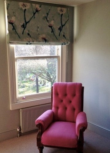 stacked floral linen roman blind with buttoned pink linen armchair
