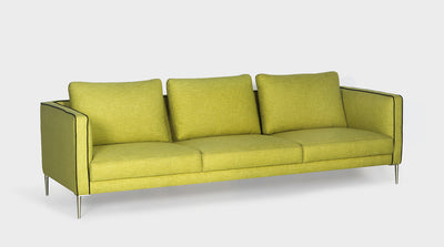 A lime green modern sofa with slim arms, sleek steel legs and black piping.