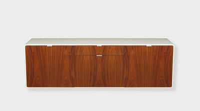 A modern, floating sideboard with curved corners, a white timber frame and walnut cupboards and drawers with slim, steel handles.