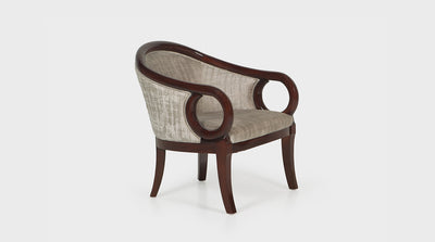 An art deco inspired occasional chair made with papyrus coloured fabric and a medium mahogany timber frame. This chair has a rounded back, circular arms and curved legs.