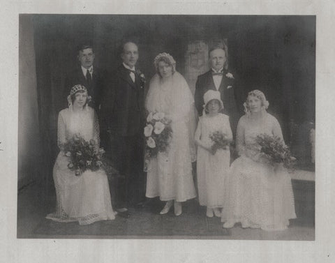 Old photograph of wedding party with bride and groom
