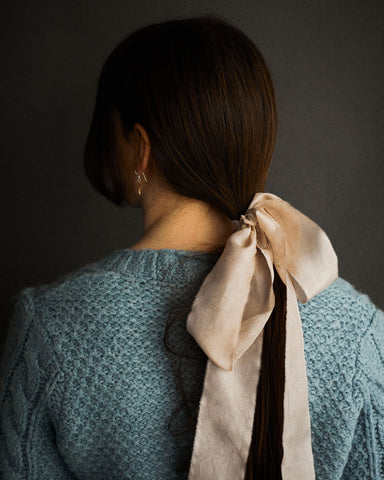 Model with madder rose silk ribbon in hair