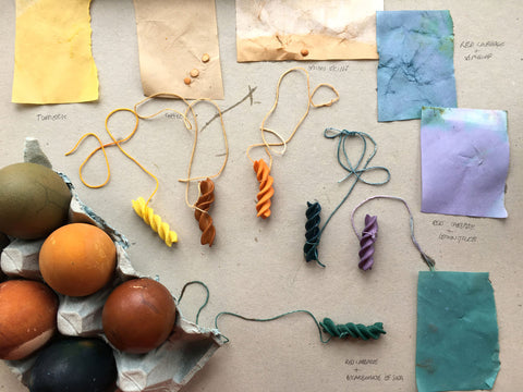 Naturally dyed Easter eggs, coloured pasta and plant dyed pieces of paper