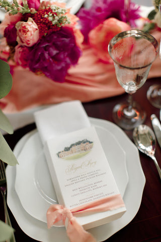 Detail of wedding table with menu wrapped in pale pink Tulip pink bamboo silk ribbon