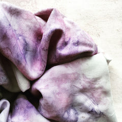 Purple patterned silk scrunchie close up