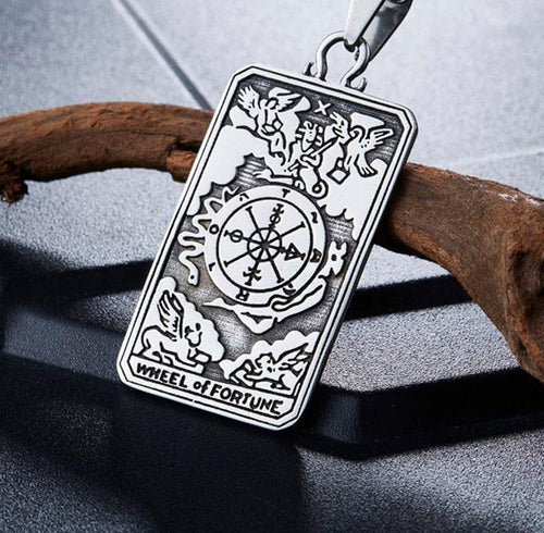 Photo of large tarot pendant necklace - wheel of fortune - signifies luck and a change of fortune