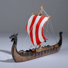 Load image into Gallery viewer, Photo of Viking ship with sail and rigging, dragon head at prow and shields along each side
