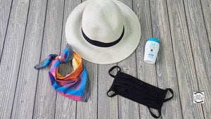 A product image of the SUN50 UPF50+ Travel Kits. This Kit is showing a Facemask, Sunscreen, Bandana, & Love Sun Body Sunscreen