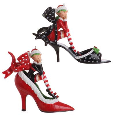 girl elf sitting in a red and black high heel shoe christmas ornament