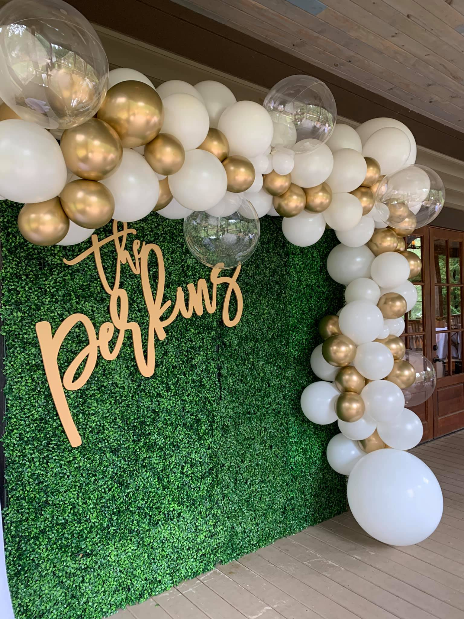 Balloon garland with clear, white and gold balloons.