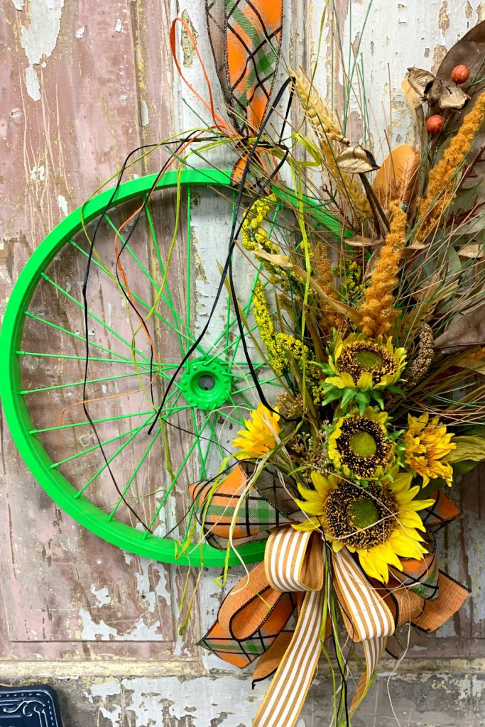 bicycle wheel, fall door hanger, sunflower pick, sunflower spray
