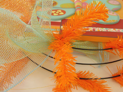 butterfly-wreath-first-pouf