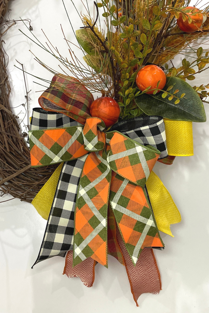 fall grapevine wreath with bow
