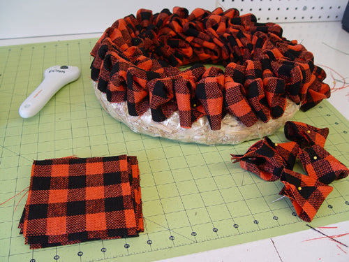 faux-burlap-orange-black-wreath-finished-making-poufs