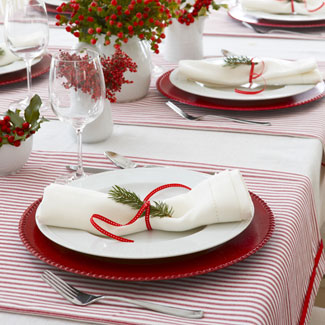 red and white peppermint styled table setting