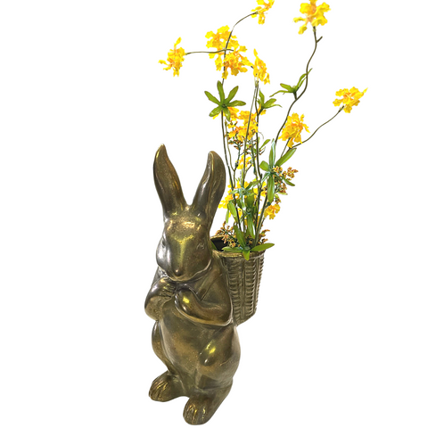 gold bunny with yellow pental blossoms