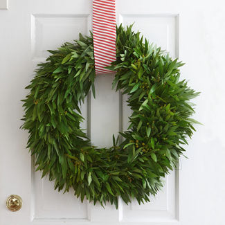 green wreath with peppermint striped ribbon